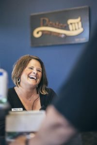 The Dexter Family Dentistry receptionist smiling at patients