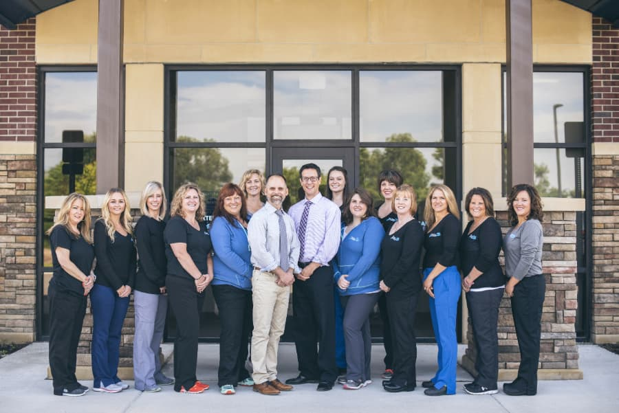 Dexter Family Dentistry staff standing outside the office