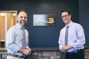 Doctor Brent Kolb and Doctor Derek Robison standing inside the office